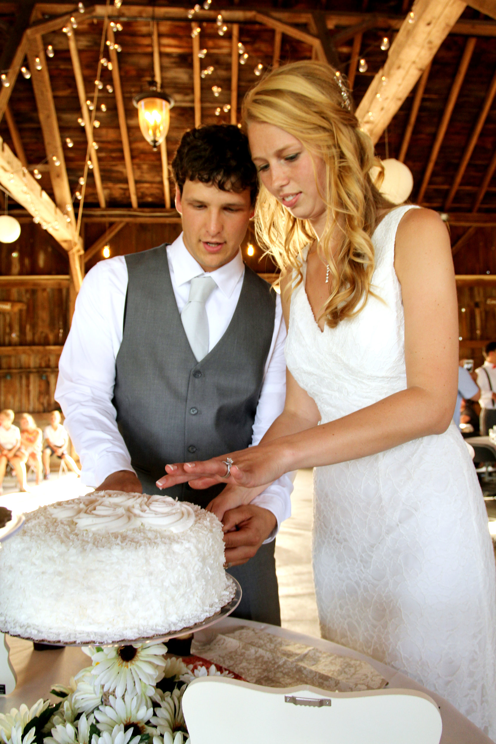 Bride And Groom Cut Wedding Cake At Barn Venue Blodgett In Schoolcraft